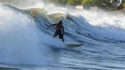 Raphael surfing in Las Penitas